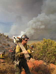 Two Granite Mountain hotshots with saws on their shoulders shortly before 4 p.m., June 30, 2013 at the Yarnell Hill Fire. Photo by Christopher MacKenzie.